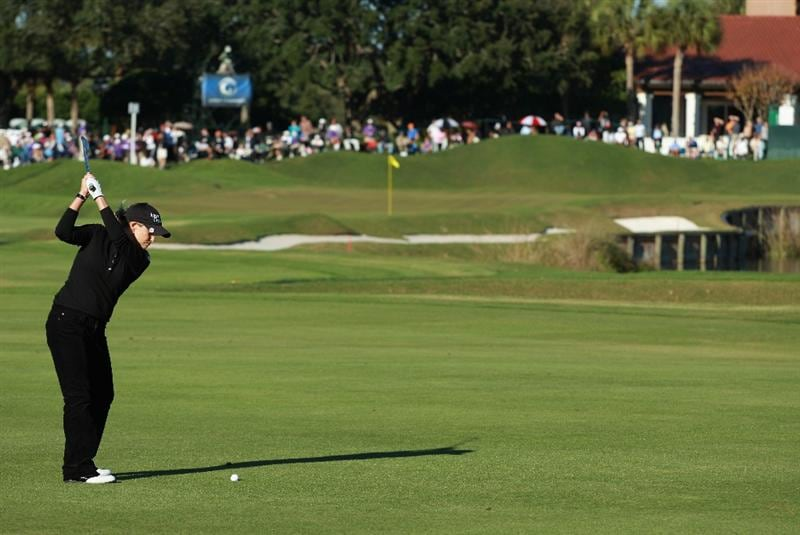 ORLANDO, FL - DECEMBER 05:  Cristie Kerr hits her approach shot on the 18th hole during the final round of the LPGA Tour Championship at the Grand Cypress Resort on December 5, 2010 in Orlando, Florida.  (Photo by Scott Halleran/Getty Images)