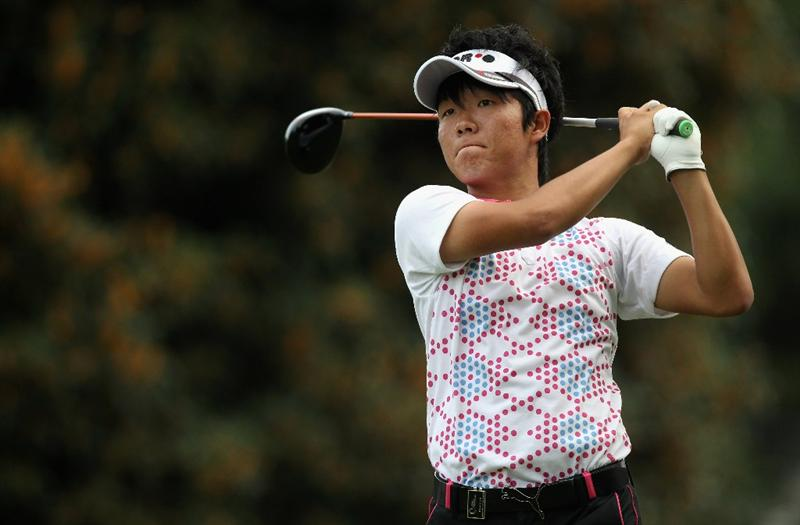 KAWAGOE CITY, JAPAN - OCTOBER 08:  Yosuke Asaji of Japan watches a tee shot on the 10th hole during the second round of the 2010 Asian Amateur Championship at Kasumigaseki Country Club on October 8, 2010 in Kawagoe City, Japan.  (Photo by Streeter Lecka/Getty Images)