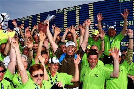 PLENEUF-VAL-ANDRE, FRANCE - APRIL 26:  Joakim Haeggman of Sweden celebrates with the marshals after winning the AGF-Allianz Open Cotes d'Armour Bretagne by one stroke at Golf Blue-Green Pleneuf-Val Andre on April 26, 2008 in Pleneuf-Val Andre, France.  (Photo by Warren Little/Getty Images)