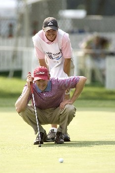Scott Weatherly and his caddie smile while lining up a putt on #18 during the Rheem Classic at Hardscrabble Country Club in Fort Smith, Arkansas on Friday May 13, 2005.Photo by Wesley Hitt/WireImage.com