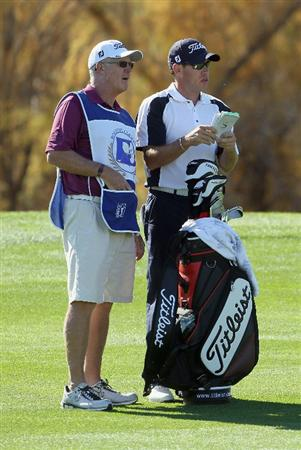 LA QUINTA, CA - JANUARY 20:  Brian Davis (R) of England and his caddie Steve Hulka discuss a shot on the 16th fairway during the second round of the Bob Hope Classic at the Nicklaus Private course at PGA West on January 20, 2011 in La Quinta, California.  (Photo by Jeff Gross/Getty Images)