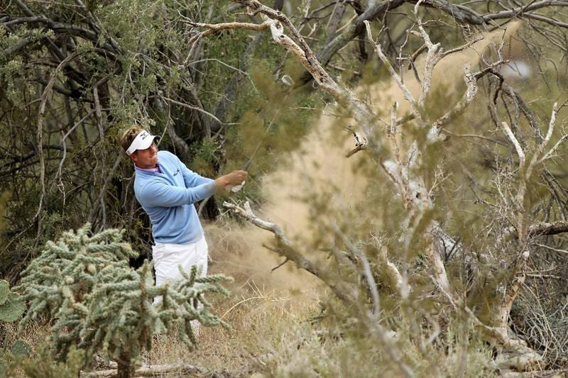MARANA, AZ - FEBRUARY 26:  Luke Donald of England hits his second shot on the 11th hole during the semifinal round of the Accenture Match Play Championship at the Ritz-Carlton Golf Club on February 26, 2011 in Marana, Arizona.  (Photo by Andy Lyons/Getty Images)