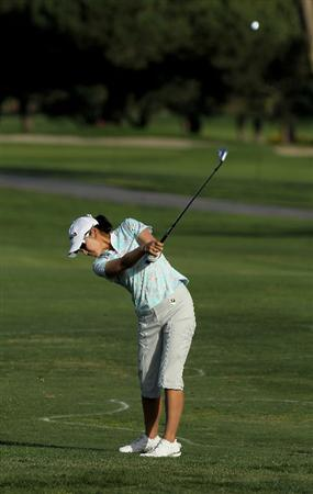 CARLSBAD, CA - MARCH 27:  Candie Kung of Taiwan hits her third shot on the 18th hole during the third round of the Kia Classic Presented by J Golf at La Costa Resort and Spa on March 27, 2010 in Carlsbad, California.  (Photo by Stephen Dunn/Getty Images)