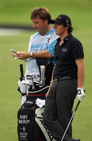 SINGAPORE - NOVEMBER 14:  Rory McIlroy of Northern Ireland weighs up his next shot during the second round of the Barclays Singapore Open at Sentosa Golf Club on November 14, 2008 in Singapore.  (Photo by Ian Walton/Getty Images)