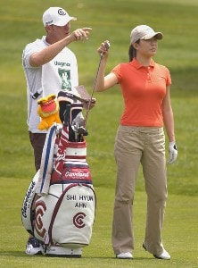 Shi Hyun Ahn pulls a club for her approach shot on the 18th hole during the second round of the Wegmans LPGA at Locust Hill Country Club in Rochester, New York on Friday, June 23, 2006.Photo by Kevin Rivoli/WireImage.com