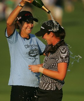 MT. PLEASANT, SC - JUNE 03:  Laura Diaz sprays first-time winner Nicole Castrale after Castrale defeated Lorena Ochoa on the first playoff hole during the final round of the Ginn Tribute hosted by ANNIKA at RiverTowne County Club on June 3, 2007 in Mt. Pleasant, South Carolina.  (Photo by Scott Halleran/Getty Images)
