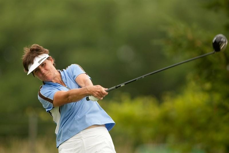 SPRINGFIELD, IL - JUNE 12: Michele Redman follows through on a tee shot during the third round of the LPGA State Farm Classic at Panther Creek Country Club on June 12, 2010 in Springfield, Illinois. (Photo by Darren Carroll/Getty Images)