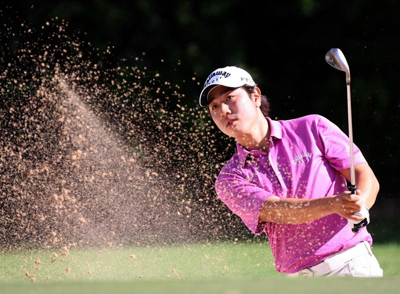 HONOLULU - JANUARY 15:  Sang-Moon Bae of South Korea plays a shot from the bunker during the first round of the Sony Open at Waialae Country Club on January 15, 2009 in Honolulu, Hawaii.  (Photo by Sam Greenwood/Getty Images)
