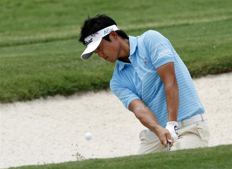 MEMPHIS, TN - JUNE 11: Ryuji Imada of Japan chips onto the 7th green during the second round of the St. Jude Classic at TPC Southwind held on June 11, 2010 in Memphis, Tennessee.  (Photo by John Sommers II/Getty Images)