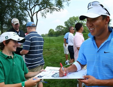 BLOOMFIELD HILLS, MI - AUGUST 05:  Anthony Kim of USA signs an autograph for a young fan during a practice round prior to the 90th PGA Championship at Oakland Hills Country Club on August 5, 2008 in Bloomfield Township, Michigan.  (Photo by Stuart Franklin/Getty Images)