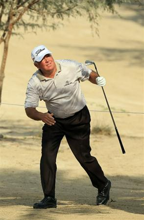 DUBAI, UNITED ARAB EMIRATES - FEBRUARY 10:  Mark O'Meara of the USA plays his second shot to the 14th hole during the first round of the 2011 Omega Dubai Desert Classic on the Majilis Course at the Emirates Golf Club on February 10, 2011 in Dubai, United Arab Emirates.  (Photo by David Cannon/Getty Images)