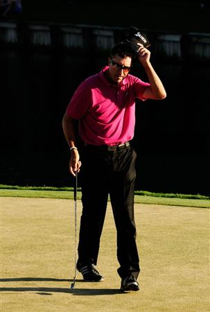 PONTE VEDRA BEACH, FL - MAY 09:  Robert Allenby of Australia tips his cap after finishing his round on the 18th green during THE PLAYERS Championship held at THE PLAYERS Stadium course at TPC Sawgrass on May 9, 2010 in Ponte Vedra Beach, Florida.  (Photo by Sam Greenwood/Getty Images)