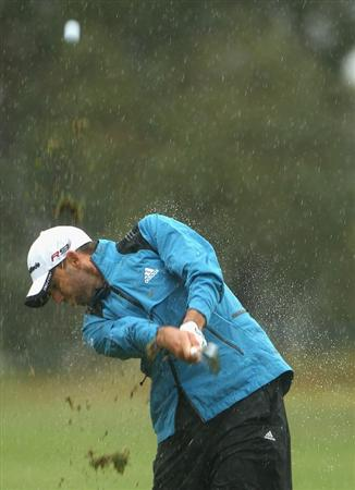 MELBOURNE, AUSTRALIA - NOVEMBER 13:  Sergio Garcia of Spain hits an iron shot in heavy rain during round three of the Australian Masters at The Victoria Golf Club on November 13, 2010 in Melbourne, Australia.  (Photo by Ryan Pierse/Getty Images)