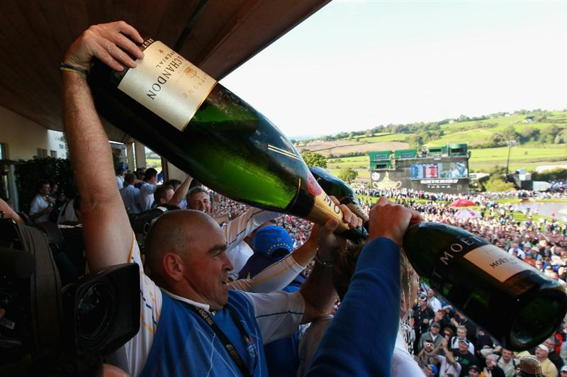 NEWPORT, WALES - OCTOBER 04:  Europe Vice Captain Thomas Bjorn sprays champagne on the balcony of the clubhouse following Europe's victory during the 2010 Ryder Cup at the Celtic Manor Resort on October 4, 2010 in Newport, Wales.  (Photo by Andrew Redington/Getty Images)