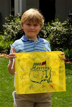 AUGUSTA, GA - APRIL 09:  A young patron waits near the clubhouse during the third day of practice prior to the start of the 2008 Masters Tournament at Augusta National Golf Club on April 9, 2008 in Augusta, Georgia.  (Photo by Andrew Redington/Getty Images)