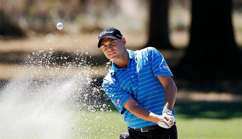 MADISON, MS - OCTOBER 02: Bill Haas hits his third shot on the first hole from a bunker during the third round of the Viking Classic held at Annandale Golf Club on October 2, 2010 in Madison, Mississippi.  (Photo by Michael Cohen/Getty Images)