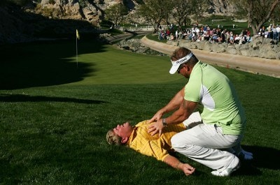 John Daly gets a massage from Jim Weathers next to the 17th green during the third round of the 49th Bob Hope Chrysler Classic on January 18, 2008 at the PGA WEST Arnold Palmer Private Course in La Quinta, California. PGA TOUR - 2008 Bob Hope Chrysler Classic - Round ThreePhoto by Robert Laberge/Getty Images