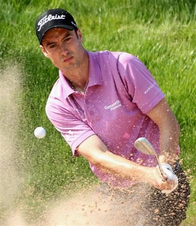NEWPORT, WALES - JUNE 03:  Ross Fisher of England plays a bunker shot on the 17th hole during the first round of the Celtic Manor Wales Open on The Twenty Ten Course at The Celtic Manor Resort on June 3, 2010 in Newport, Wales.  (Photo by Andrew Redington/Getty Images)