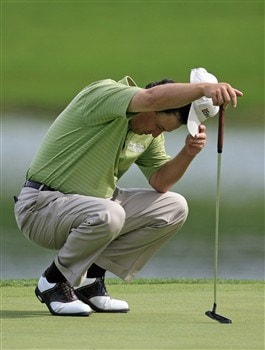 BIRMINGHAM, AL - MAY 17:  Loren Roberts lowers his head as he prepares to putt on the 18th green during round two of the Regions Charity Classic at the Ross Bridge Golf Resort on May 16, 2008 in Birmingham, Alabama. (Photo by Dave Martin/Getty Images)