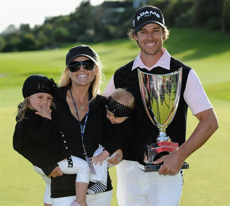 PACIFIC PALISADES, CA - FEBRUARY 20:  Aaron Baddeley of Australia poses his wife Richelle, daughters Jewel and Jolee and the tournament trophy after winning the final round of the Northern Trust Open at Riviera Country Club on February 20, 2011 in Pacific Palisades, California.  (Photo by Stuart Franklin/Getty Images)