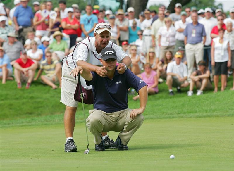 SILVIS, IL - JULY 12:  Cameron Beckman is shown the break on his putt by his caddie during the final round of the John Deere Classic at TPC Deere Run held on July 12, 2009 in Silvis, Illinois.  (Photo by Michael Cohen/Getty Images)