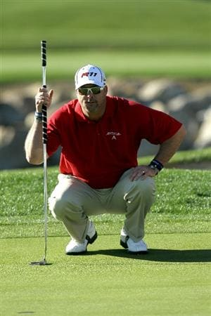 LA QUINTA, CA - JANUARY 21:  Chris Couch lines up a putt on the tenth hole during round three of the Bob Hope Classic at the Palmer Private Course at PGA West on January 21, 2011 in La Quinta, California.  (Photo by Stephen Dunn/Getty Images)
