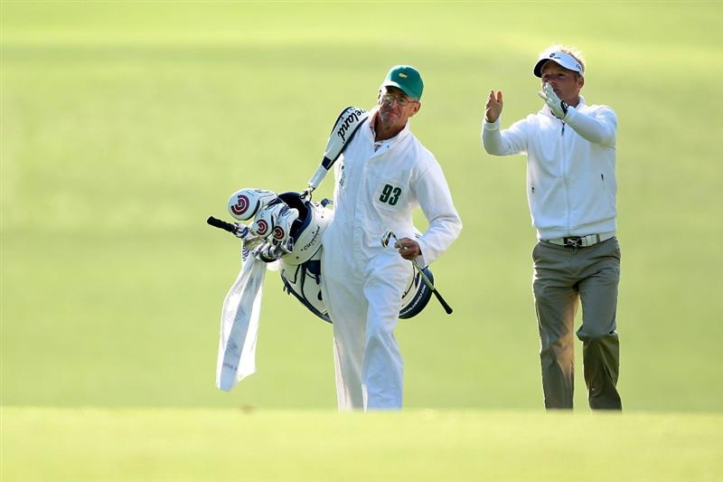 AUGUSTA, GA - APRIL 09:  Soren Kjeldsen of Denmark (R) talks with is caddie Kevin Woodward on the first hole during the second round of the 2010 Masters Tournament at Augusta National Golf Club on April 9, 2010 in Augusta, Georgia.  (Photo by Andrew Redington/Getty Images)
