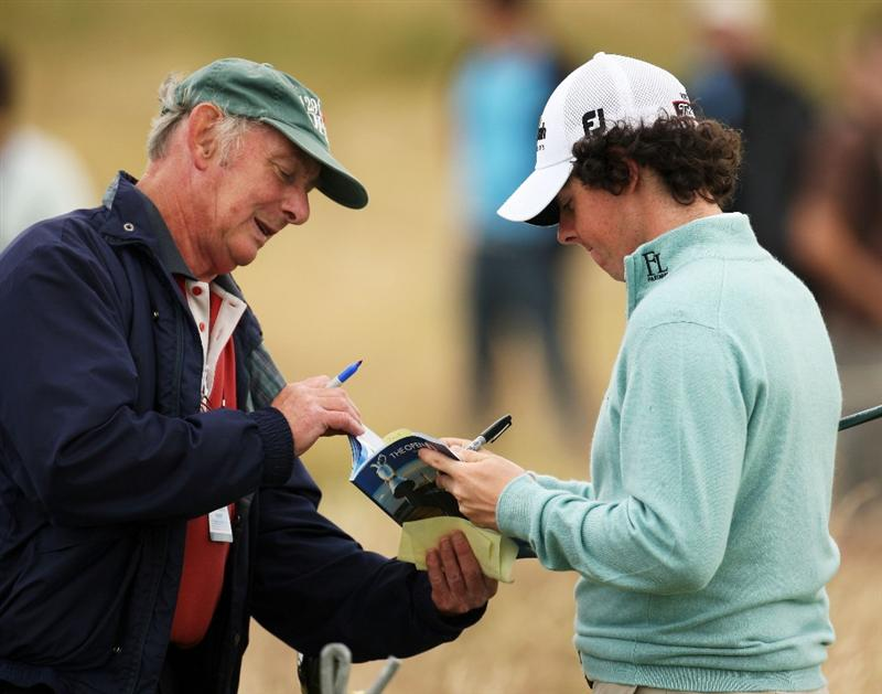 TURNBERRY, SCOTLAND - JULY 13:  Rory McIlroy of Northern Ireland signs autographs during the practice round of the 138th Open Championship on July 13, 2009 on the Ailsa Course, Turnberry Golf Club, Turnberry, Scotland.  (Photo by Ross Kinnaird/Getty Images)