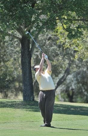 SAN ANTONIO- OCTOBER 9: Tim Herron hits his approach shot into the 18th hole during the first round of the Valero Texas Open  held at La Cantera Golf Club on October 9, 2008 in San Antonio, Texas  (Photo by Marc Feldman\Getty Images)