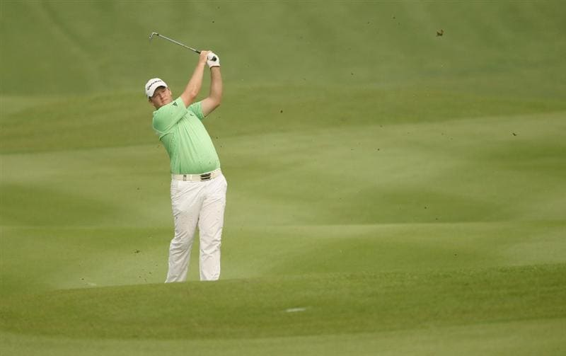 KUALA LUMPUR, MALAYSIA - APRIL 14:  Marcus Fraser of Australia in action during the first round of the Maybank Malaysian Open at Kuala Lumpur Golf & Country Club on April 14, 2011 in Kuala Lumpur, Malaysia.  (Photo by Ian Walton/Getty Images)