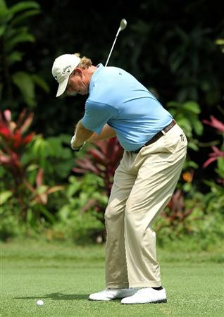 KUALA LUMPUR, MALAYSIA - OCTOBER 28: Ernie Els of South Africa hits his 2nd shot on the 1st hole during day one of the CIMB Asia Pacific Classic at The MINES Resort & Golf Club on October 28, 2010 in Kuala Lumpur, Malaysia. (Photo by Stanley Chou/Getty Images)