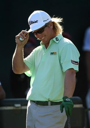 SCOTTSDALE, AZ - FEBRUARY 01:  Charley Hoffman laughs as the gallery chants 'Supercuts!' as he waits to tee off on the 16th hole during the final round of the FBR Open on February 1, 2009 at TPC Scottsdale in Scottsdale, Arizona.  (Photo by Stephen Dunn/Getty Images)