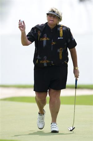 CHON BURI, THAILAND - FEBRUARY 19:  Laura Davies of England acknowledges the crowd on the 8th green during round two of the Honda LPGA Thailand at the Siam Country Club on February 19, 2010 in Chon Buri, Thailand.  (Photo by Victor Fraile/Getty Images)