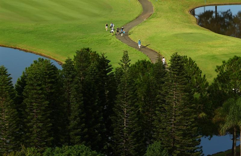 GOLD COAST, AUSTRALIA - MARCH 05:  A general view of golfers walking up the 10th fairway during round two of the 2010 ANZ Ladies Masters at Royal Pines Resort on March 5, 2010 in Gold Coast, Australia.  (Photo by Ryan Pierse/Getty Images)
