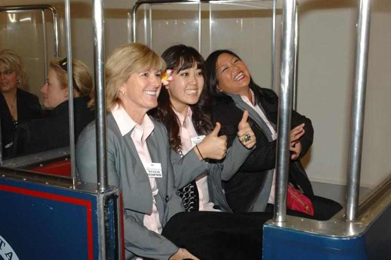 WASHINGTON - JANUARY 12:  (L-R) Beth Daniel, Michelle Wie, and  Christina Kim of the 2009 United States Solheim Team ride the senators tram at the Capital during visit to celebrate team win in Solheim Cup January 12, 2010 in Washington, DC.  (Photo by Mitchell Layton/Getty Images)