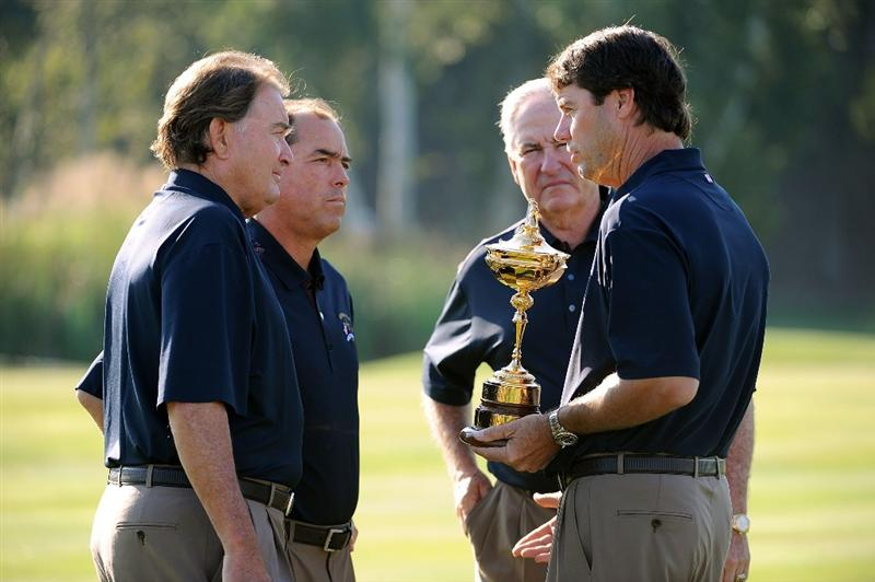 LOUISVILLE, KY - SEPTEMBER 17:  USA team captain Paul Azinger speaks to his assistant coaches Raymond Floyd, Olin Browne and Dave Stockton during the USA team photo shoot prior to the 2008 Ryder Cup at Valhalla Golf Club on September 17, 2008 in Louisville, Kentucky.  (Photo by Harry How/Getty Images)