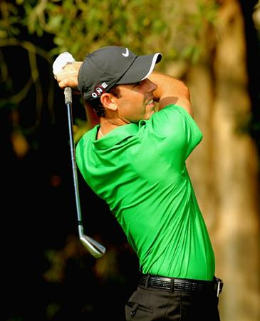HONG KONG - NOVEMBER 18: Charl Schwartzel of South Africa plays his 2nd shot on the 3rd hole during the first round of the USB Hong Kong Open at The Hong Kong Golf Club  on November 18, 2010 in Hong Kong, Hong Kong.  (Photo by Stanley Chou/Getty Images)