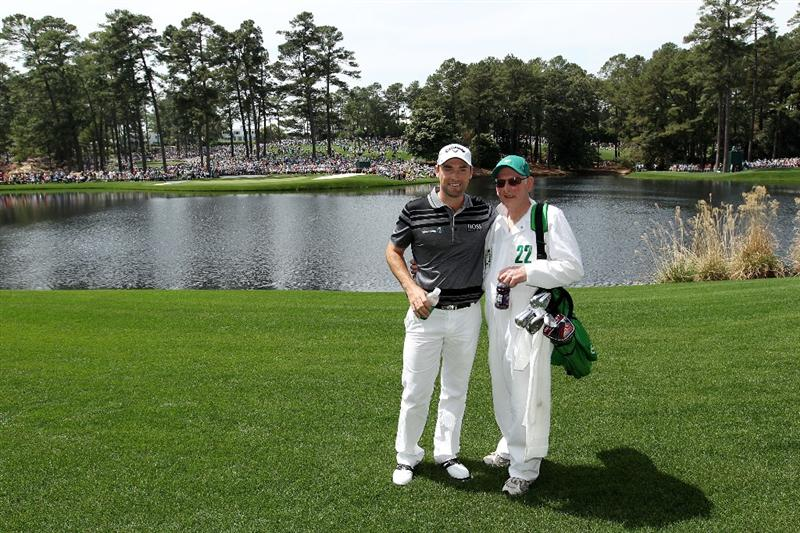 AUGUSTA, GA - APRIL 07:  Oliver Wilson of England poses with his caddie/father during the Par 3 Contest prior to the 2010 Masters Tournament at Augusta National Golf Club on April 7, 2010 in Augusta, Georgia.  (Photo by Andrew Redington/Getty Images)