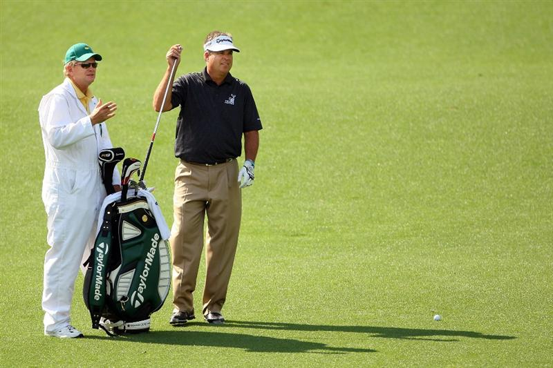AUGUSTA, GA - APRIL 11:  Kenny Perry pulls a club on the ninth hole alongside his caddie Fred Sanders during the third round of the 2009 Masters Tournament at Augusta National Golf Club on April 11, 2009 in Augusta, Georgia.  (Photo by Andrew Redington/Getty Images)
