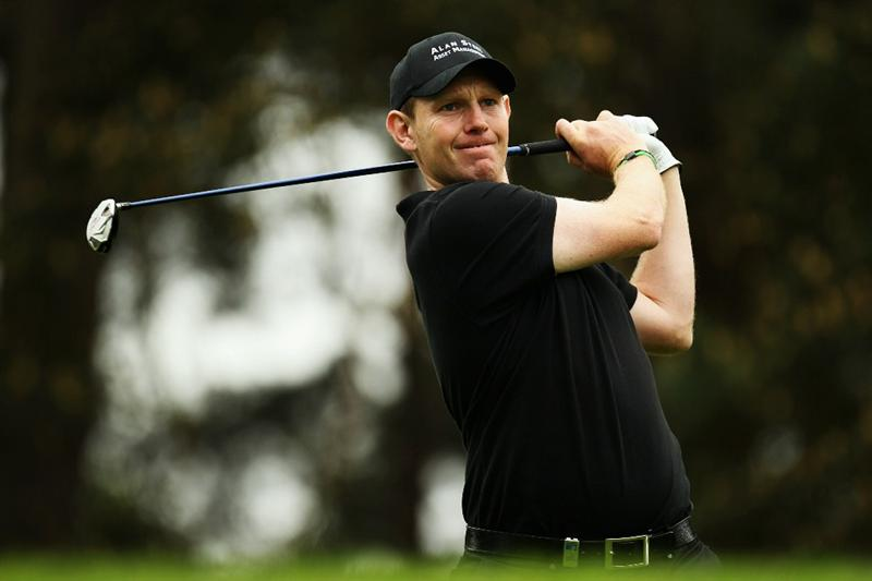 VIRGINIA WATER, ENGLAND - MAY 20:  Stephen Gallacher of Scotland plays a tee shot during the first round of the BMW PGA Championship on the West Course at Wentworth on May 20, 2010 in Virginia Water, England.  (Photo by Ross Kinnaird/Getty Images)