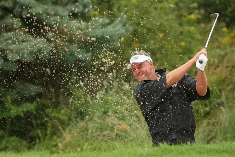 LUSS, SCOTLAND - JULY 12:  Darren Clarke of Northern Ireland hits out of a bunker during the Final Round of The Barclays Scottish Open at Loch Lomond Golf Club on July 12, 2009 in Luss, Scotland.  (Photo by Andrew Redington/Getty Images)