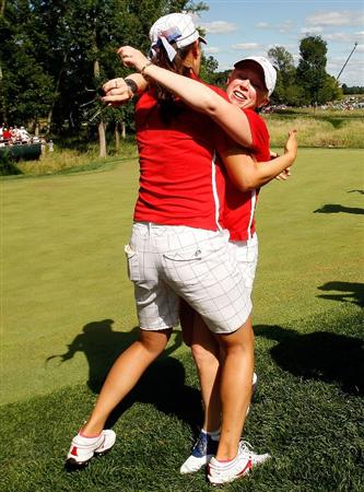 SUGAR GROVE, IL - AUGUST 23:  Morgan Pressel is greeted on the 16th green by Michelle Wie after Pressel clinched the Solheim Cup for the U.S. Team during the Sunday singles matches at the 2009 Solheim Cup at Rich Harvest Farms on August 23, 2009 in Sugar Grove, Illinois.  (Photo by Chris Graythen/Getty Images)