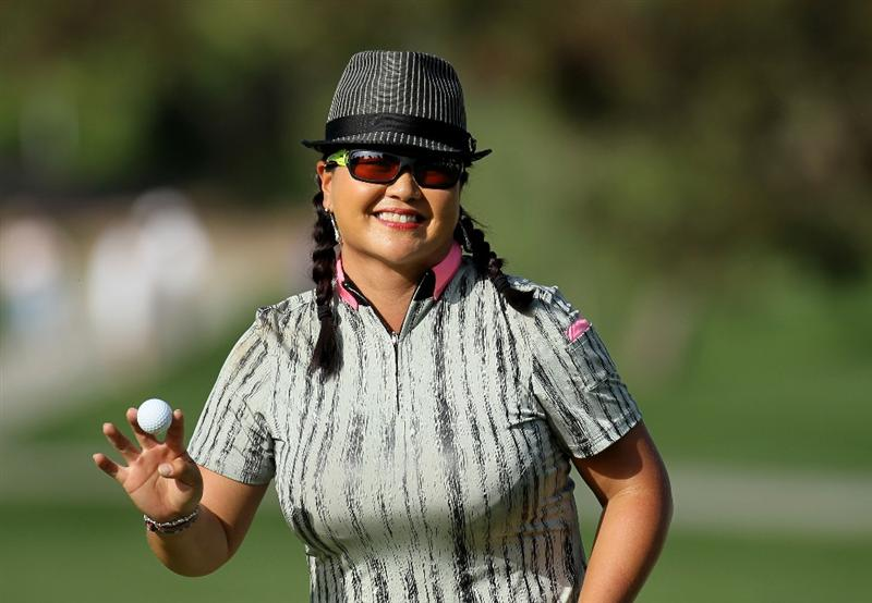 CARLSBAD, CA - MARCH 27:  Christina Kim holds up her ball after making a putt on the 14th hole during the third round of the Kia Classic Presented by J Golf at La Costa Resort and Spa on March 27, 2010 in Carlsbad, California.  (Photo by Stephen Dunn/Getty Images)