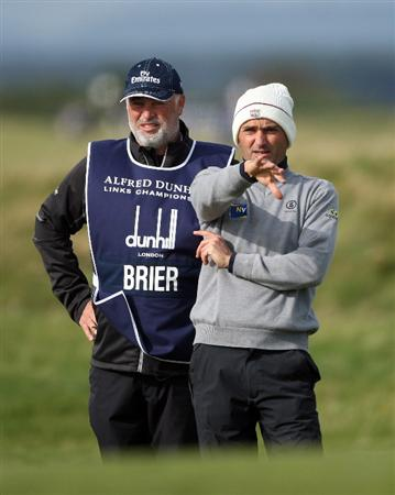 ST ANDREWS, SCOTLAND - OCTOBER 01:  Markus Brier of Austria waits with his caddie on the 17th hole during the first round of The Alfred Dunhill Links Championship at The Old Course on October 1, 2009 in St. Andrews, Scotland.  (Photo by Andrew Redington/Getty Images)