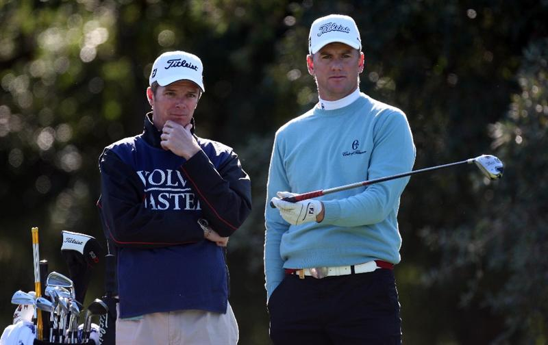 SOTOGRANDE, SPAIN - OCTOBER 29:  Robert Karlsson of Sweden and his caddie Gareth Lord has a giscussion on the par four 2nd hole during the pro-am event prior to the Volvo Masters at the Valderrama Golf Club on October 29, 2008 in Sotogrande, Spain  (Photo by Ross Kinnaird/Getty Images)