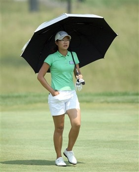 HAVRE DE GRACE, MD - JUNE 07:  Ji Young Oh of South Korea takes shelter from the hot sun as she walks to her second shot at the 1st hole during the third round of the 2008 McDonald's LPGA Championship held at Bulle Rock Golf Course, on June 7, 2008 in Havre de Grace, Maryland.  (Photo by David Cannon/Getty Images)