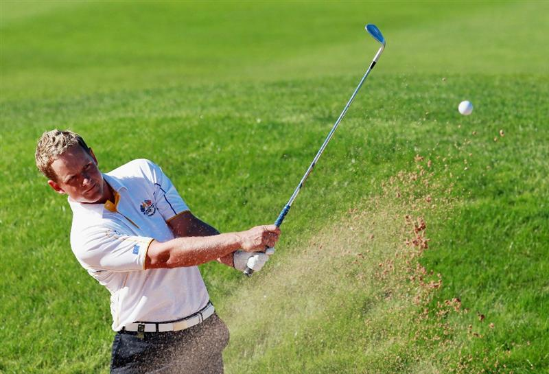 NEWPORT, WALES - OCTOBER 04:  Luke Donald of Europe hits from a bunker on the 14th hole in the singles matches during the 2010 Ryder Cup at the Celtic Manor Resort on October 4, 2010 in Newport, Wales.  (Photo by Andrew Redington/Getty Images)