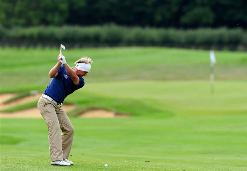 PARIS - SEPTEMBER 23:  Pelle Edberg of Sweden plays his approach shot on the 15th hole during the first round of the Vivendi cup at Golf de Joyenval on September 22, 2010 in Chambourcy, near Paris, France.  (Photo by Stuart Franklin/Getty Images)