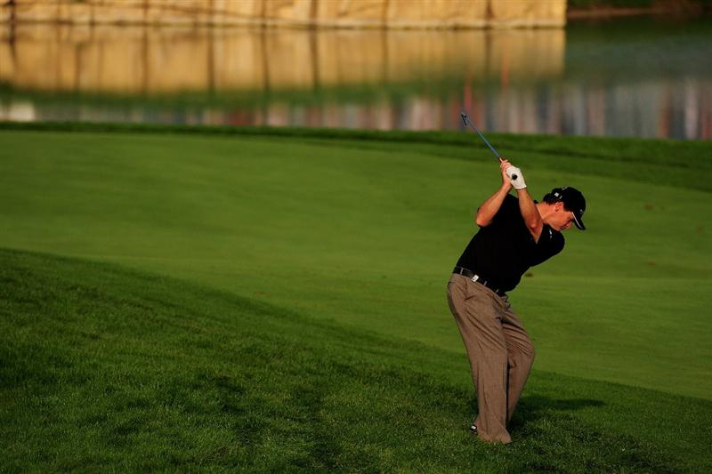VIENNA, AUSTRIA - SEPTEMBER 18:  Paul Lawrie of Scotland plays into the 18th green during the second round of the Austrian Golf Open at Fontana Golf Club on September 18, 2009 in Vienna, Austria.  (Photo by Richard Heathcote/Getty Images)