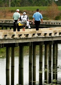 Frank Lickliter II and Lucas Glover make their way across a woo bridge after hitting their tee shot on the sixth hole during the Ginn Sur Mer Classic at Tesoro on October 25, 2007 in Port Saint Lucie, Florida. PGA TOUR - 2007 Ginn su Mer Classic - First RoundPhoto by Doug Benc/WireImage.com
